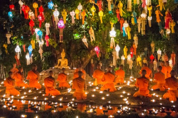 Buddhist monks praying for the Loy Krathong festival in Chiang Mai, Thailand.