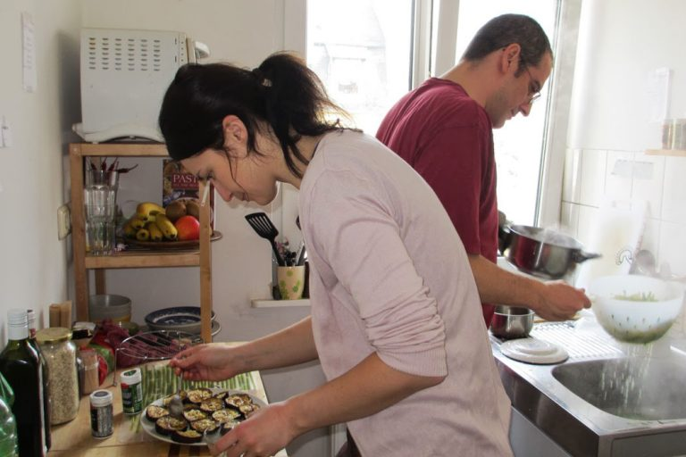Ivana and Gianni while cooking for a dinner with friends.