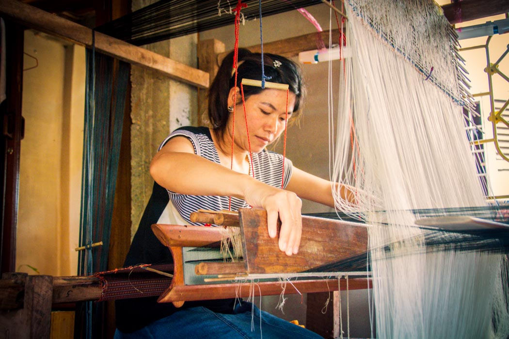 A Laotian woman weaving in the traditional way. Luang Prabang, Laos.