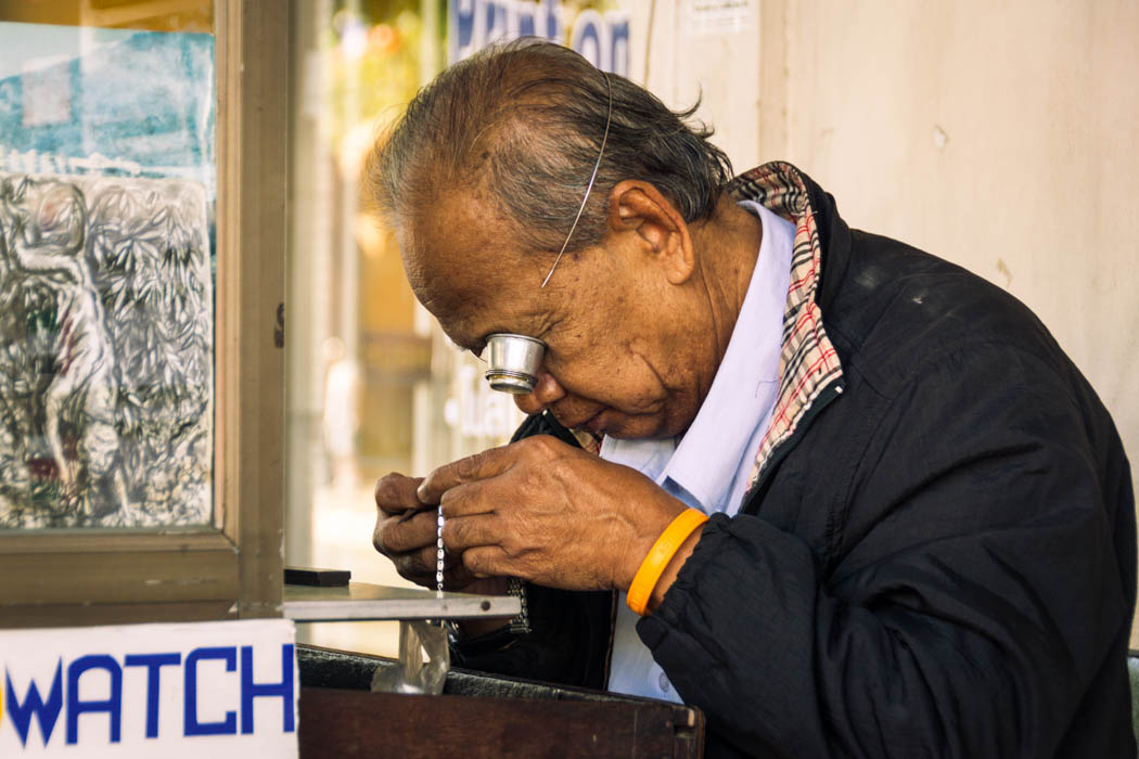 A clocksmith repairing a watch in Chiang Mai, Thailand.