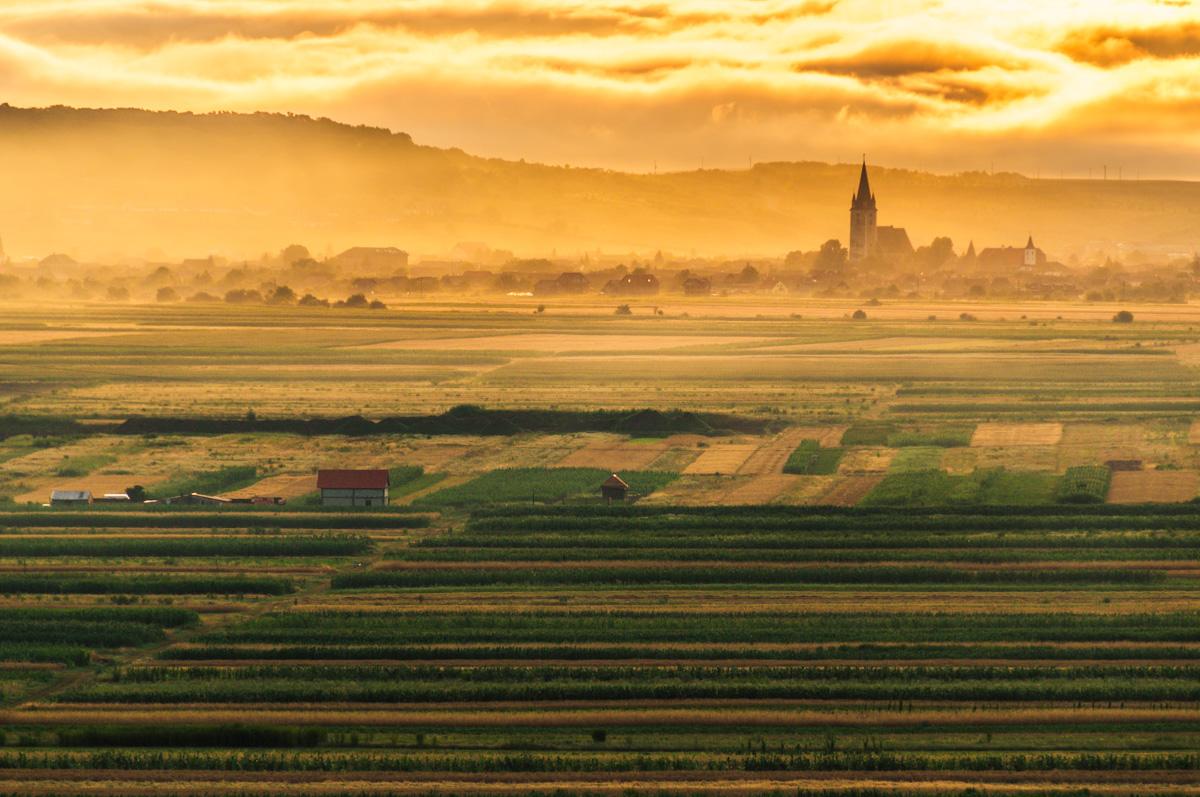 Dawn over the village of Orlat, Romania.