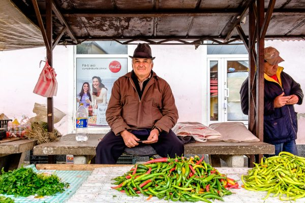 A local farmer selling chilies at the market.